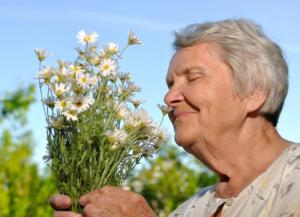 senior-smelling-flowers